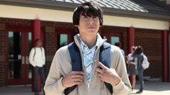 High school student outside school building Stock Footage
