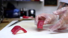 Chef prepares maguro sushi Stock Footage