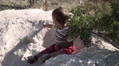 Toddler plays on the sand heap 3 Stock Footage