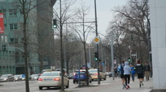 2 men 1 woman out for a sport run jog in the city, Berlin, Germany - stock footage