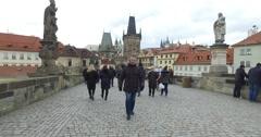 Walking with tourists over Charles,Karlov Bridge,Prague,Praha,Czech Republic 4 Stock Footage