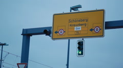 Traffic street sign with directions to Schöneberg, Kreuzberg, Berlin, Germany Stock Footage