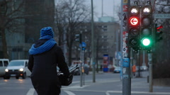 Bicycle lane path stoplight turns green, cyclists cross road, Berlin, Germany - stock footage