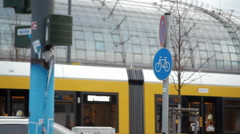 Bicycle lane path sign, yellow tram background, Berlin, Germany Stock Footage