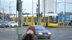 Busy intersection, yellow tram crosses, cold winter day, Berlin, Germany Stock Footage