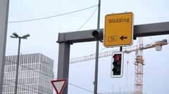 Stoplight road sign leads to Wedding neighborhood, Berlin, Germany Stock Footage