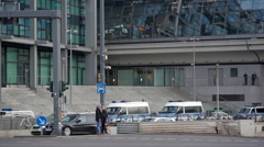 Police car vans parked, Berlin Central train station, high security, Germany Stock Footage