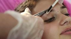 Model eyebrow shaping - stock footage