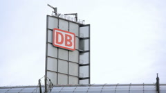 Deutsche Bahn DB logo sign on Berlin Central train station, Germany Stock Footage