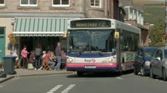 Local bus passing through the town of Melrose, Scottish Borders Stock Footage