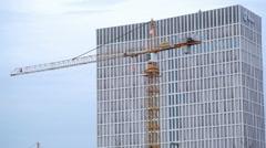 Construction site yellow crane, city development in Berlin, Germany Stock Footage
