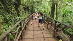 Kids Running down Path Through Jungle Stock Footage