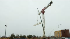 Assembling a large construction crane,  time-lapse Stock Footage