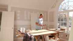 Carpenter Working On New Home Construction Stock Footage