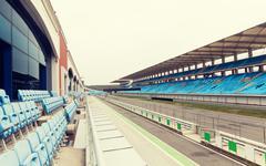 Empty speedway and bleachers on stadium Kuvituskuvat