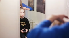 Hairdresser combing her hair of cute little girl Stock Footage