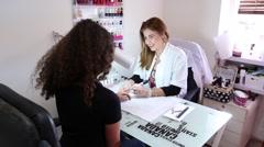 Manicurist nail polish beauty clinic - stock footage