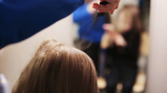 Stock Video Footage of hairdresser combing her hair of cute little girl