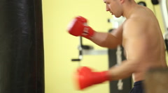 man boxing on pear - stock footage
