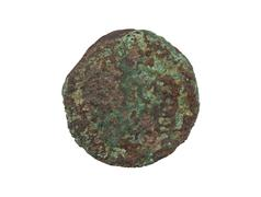 Unrecognisable old coin, rusted and green, isolated - stock photo