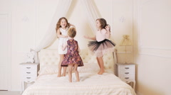 Little kids jumping on the bed Stock Footage