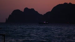 Beautiful Thai bay at Phi Phi Island. Speed boat near Phi Phi at sunset - stock footage