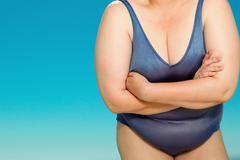 Overweight woman in swim suit Stock Photos