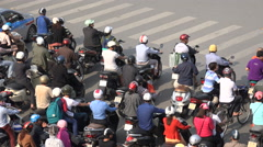 Accelerating motorbikes at traffic light during rush hour in Hanoi, Vietnam Stock Footage