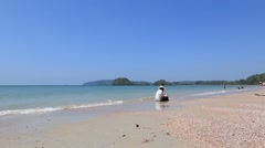 Nopparat Thara Beach near Krabi. Thai Lady looking for clams in the sand. Stock Footage