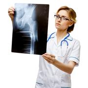 Woman doctor standing on white background - stock photo