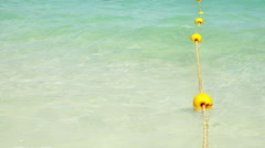 Yellow buoy with wave on the beach Stock Footage
