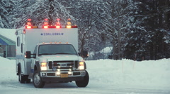 Emergency Medical Vehicle Moving Through Snow Conditions Stock Footage