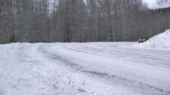 Family Truck Type Vehicle Passing on Snow Covered Highway Stock Footage