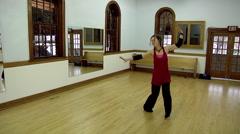 Female Dancer Practicing Dance On Wood Floor - stock footage