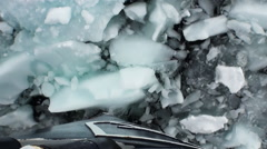 Ice floats on the ocean surface in the Antarctic. Stock Footage