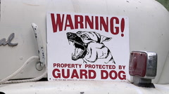 Guard Dog Sign on Old Schoolbus Stock Footage