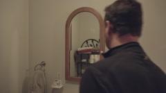 Man and Bathroom Medicine Cabinet Stock Footage