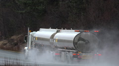 Oil Tanker 18 Wheeler Passing In The Rain and Misty Stock Footage