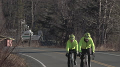 Road Cyclists Wearing Bright Green Jerseys Stock Footage