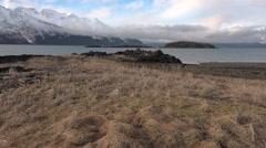 Rocky Grassy Alaska Coastal Area and Mountains Stock Footage