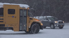 School Bus Passing in Severe Snow Storm Stock Footage