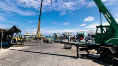 Timelapse of Fishing Boats Docked at a Pier Stock Footage