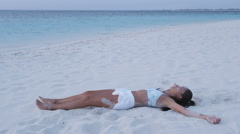 Tired exhausted fitness woman relax after workout after workout training beach Stock Footage