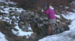 Woman Drinking Fresh Spring Water Stock Footage