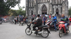 St Joseph Cathedral, people go home after Sunday mass, Hanoi, Vietnam Stock Footage
