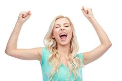 happy young woman or teen girl celebrating victory - stock photo