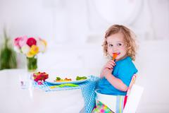 Little girl having lunch Kuvituskuvat
