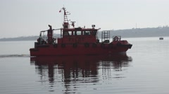 Fire boat floats on the river, the city on the horizon, on river port Stock Footage
