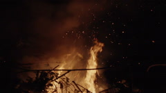 Hot Glowing Bonfire Embers Flying Up Into The Night Sky Stock Footage