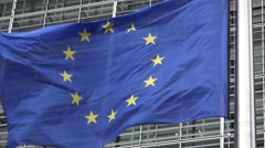 European Union flag in front of European Commission in Brussels - stock footage
